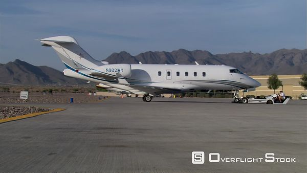 Aerial view of executive jet on tarmac.