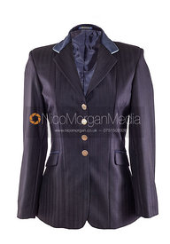 Stock image - Blue equestrian showing jacket on white background