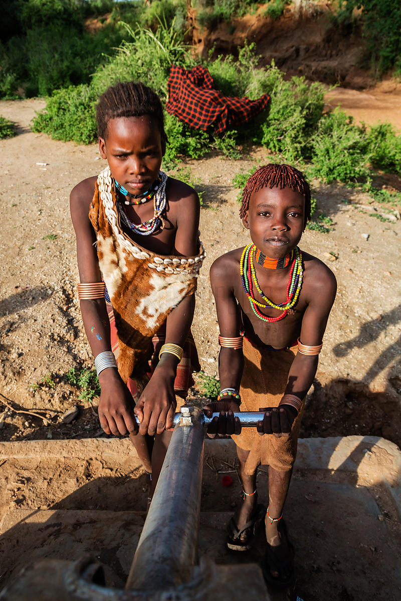 Hamer Girls Operating the Village Water Pump