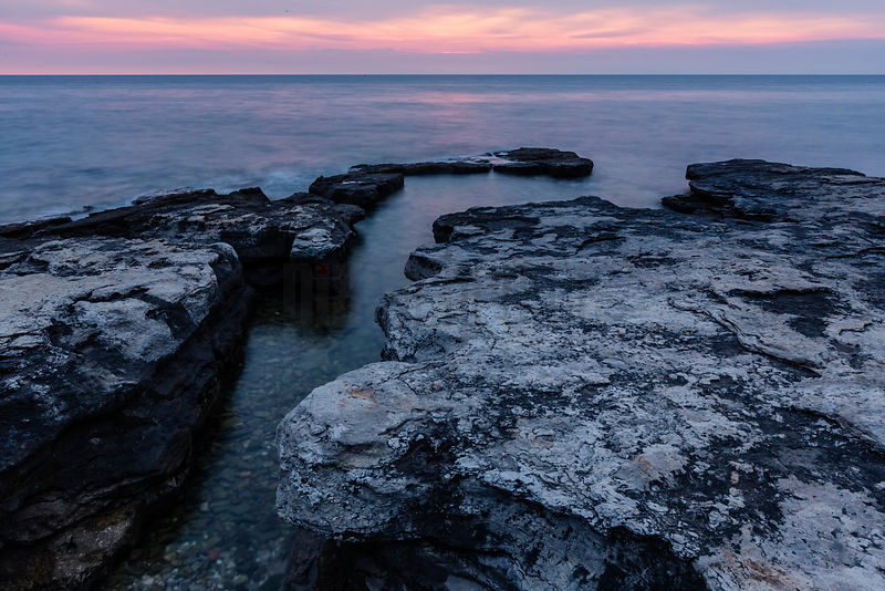 Rocky Shoreline at Sunset