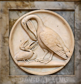Pelican in her piety a marble carving in Gloucester Cathedral
