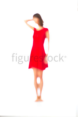 An abstract blurred figure of a woman in a red dress – shot from mid level.