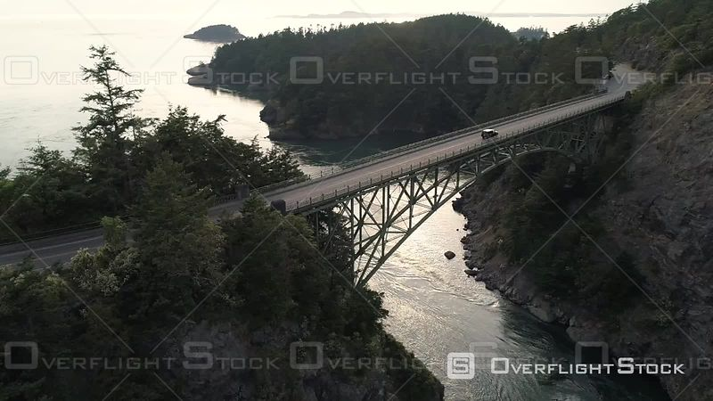 Car traveling in Pacific Northwest on bridge crossing Puget Sound ocean water. Deception Pass Washington USA