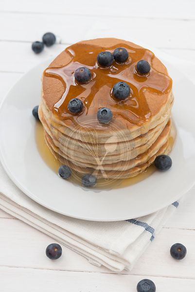 Pancakes, blueberries and honey.