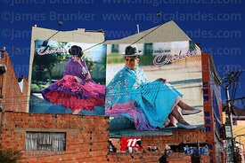 Adverts for Cholita Collection fashion campaign on wall of building, El Alto, Bolivia