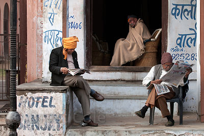 Men read the morning paper in Pushkar, Rajasthan, India