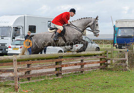 Stephen Rayns jumping a hunt jump behind the kennels