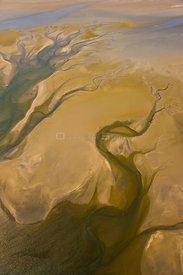 Aerial view of water flowing out of a salt pan near the atlantic coast, Walvis Bay, Namib desert, Namibia, August 2008
