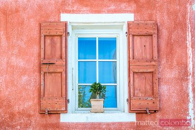 Typical colorful window in an old french town, Provence, France