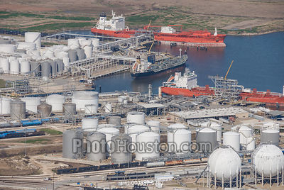 Oil tankers and storage tanks at an oil terminal
