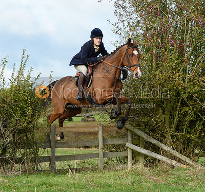 Joanna Hewitt jumping a hedge near Little Dalby. Quorn Hunt Opening Meet 2018