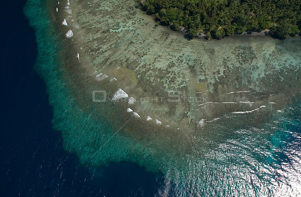 Aerial view of fringing coral reef, Papua New Guinea, August 2007