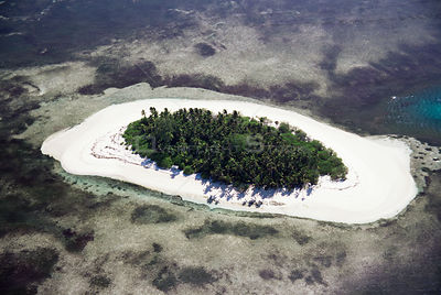 Aerial view of Alphonse island, coral atoll surrounded by coral reef, Seychelles, Indian Ocean
