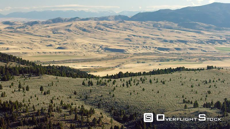 Wide open sagebrush covered meadows and dense forests cover the foothills of the Gravelly mountain range in southwestern Mont...