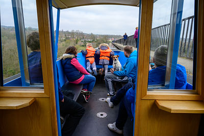 A family enjoying a trip over the Pontcysyllte Aqueduct in Wales.