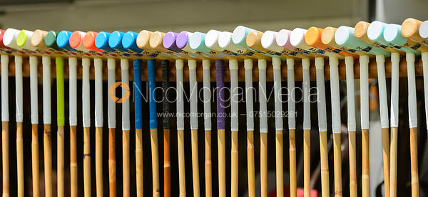 A row of brightly coloured polo sticks (mallets) - Rutland Polo Club