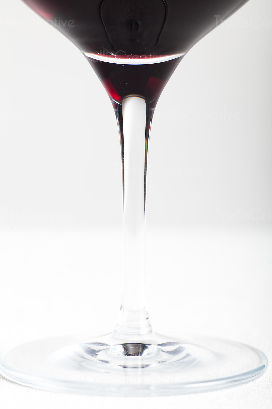 Detail shot of red wine in a glass on a white background