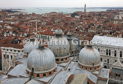 Looking north-west from The Campanile over the five domes of St Mark's Basilica (Basilica San Marco), Venice, Italy