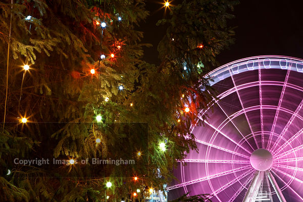 Christmas Tree and Birmingham Wheel in Centenary Square, off Broad Street in Birmingham, UK.