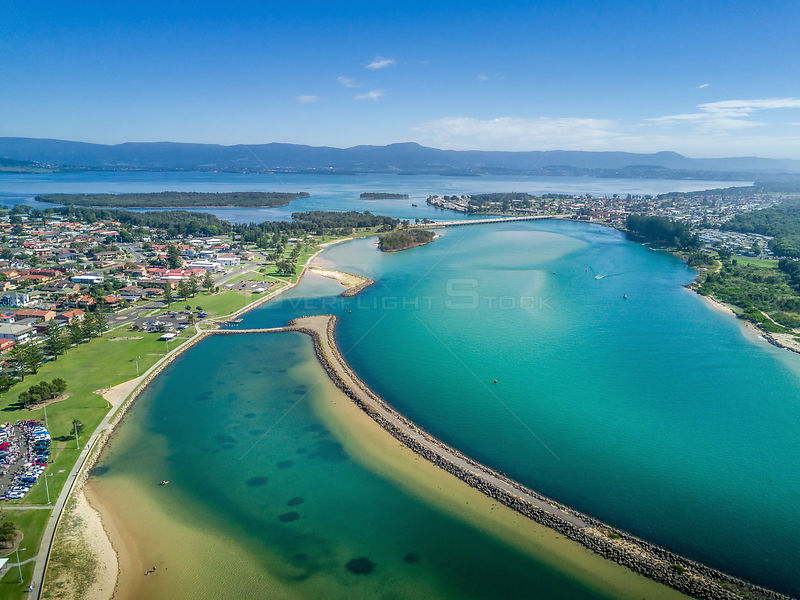 Lake Illawarra with its many breakwalls (groynes) to help channel water, stop erosion and create safe areas for publc.  In th...