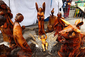 Nativity scene with carved wooden figures in square, La Paz, Bolivia