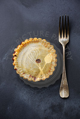 Homemade Pie and fork on blackboard background