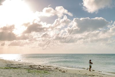 Father With Baby on Beach in Cozumel