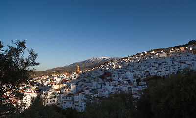 Competa with snow-capped La Maroma