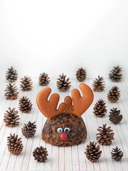 Christmas puddings with reindeer antlers and pine cones