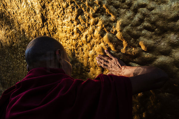 Monk Applying Gold Leaf to the Golden Rock