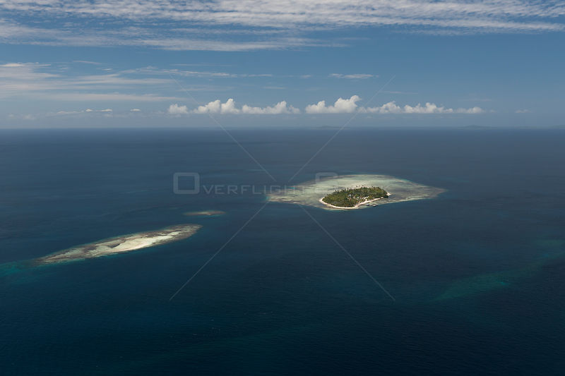 Aerial view of Arborek Island and neighbouring sand cay. Raja Ampat, West Papua, Indonesia, February 2010