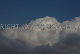 Clouds and blue sky aerial photograph of a Cumulus clouds shot against a deep blue sky