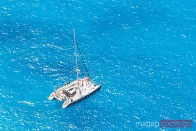 Aerial view of catamaran and blue sea, Zakynthos, Greece