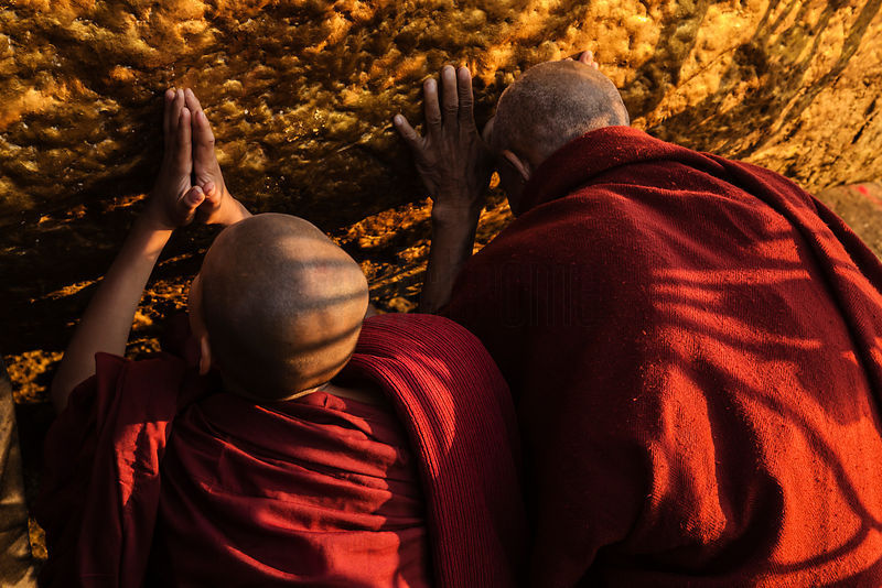 Buddhist Monks Worshipping at the Golden Rock