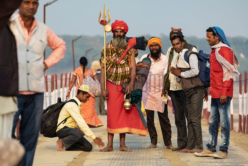 A Sadhu Poses for a Photograph on a Pontoon that Crosses the Ganges