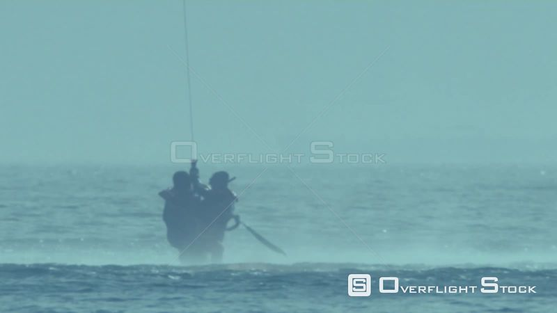 Aerial slow motion shot of two men being airlifted out of the sea Cape Town Western Cape South Africa