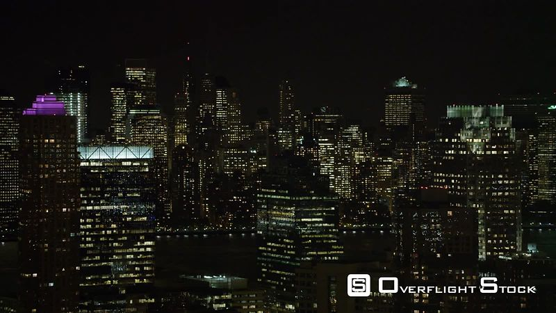 Over Jersey City at Night, New York Financial District in Background.