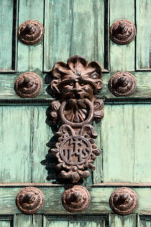 Door knocker with christogram symbol on main entrance of Compañia de Jesus Jesuit church, Cusco, Peru