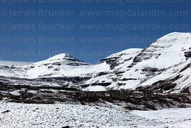 Mt Wisuyu (L) after winter snowfall, Cordillera Real, Bolivia