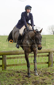 Phoebe Buckley jumping a hunt jump off Stygate Lane