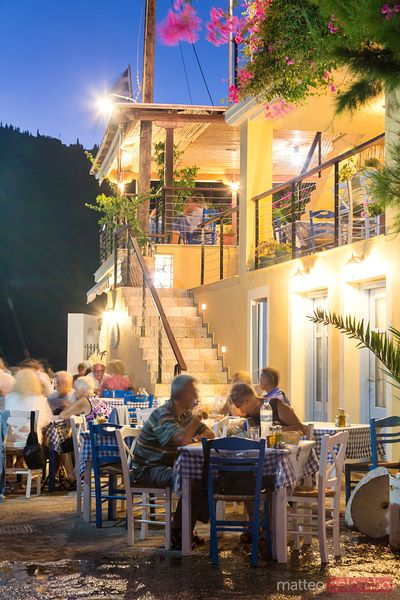 Tourists eating out in a small greek island. Kefalonia, Greek Islands, Greece