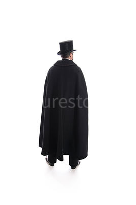 A Victorian man in a hat and cloak – shot from eye level.