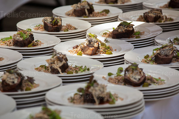 Stacks of plates with delicious meat and farro preparation for dinner