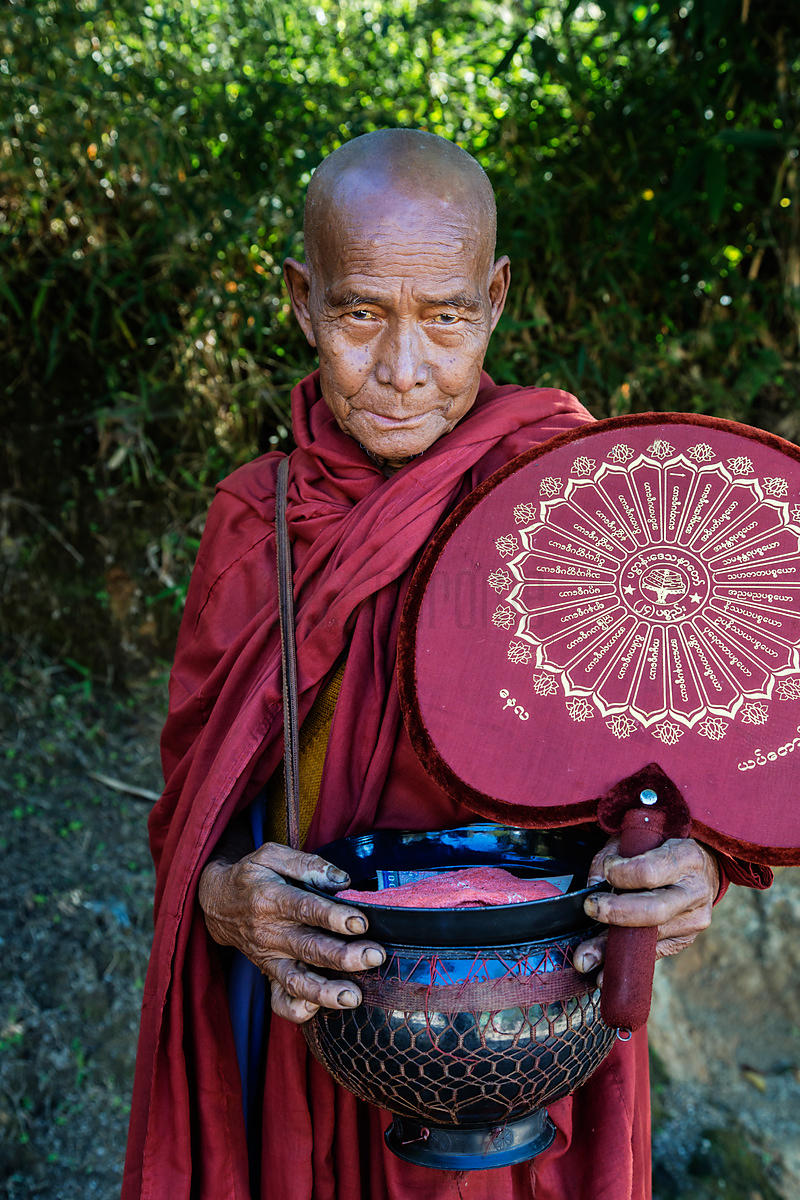 Buddhist Monk Collecting Alms