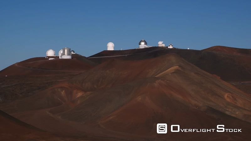 Past cinder cones on Mauna Loa with observatory in background.