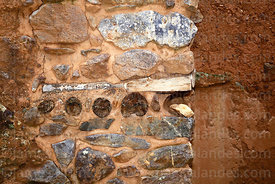 Detail of wooden beams in wall of  building in Inca site of Pumamarca, Patacancha Valley, Cusco Region, Peru