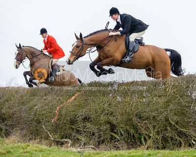 Jonty Evans and William Bell jump a big hedge on Flitteris Park