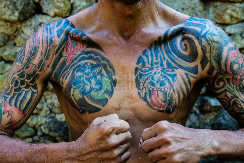Tattoos on Upper Body of Man