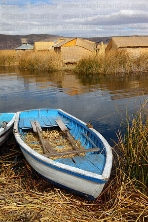 Rowing boat on Uros floating reed islands , Lake Titicaca , Peru