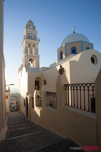 Traditional church and street in a small greek village in Santorini